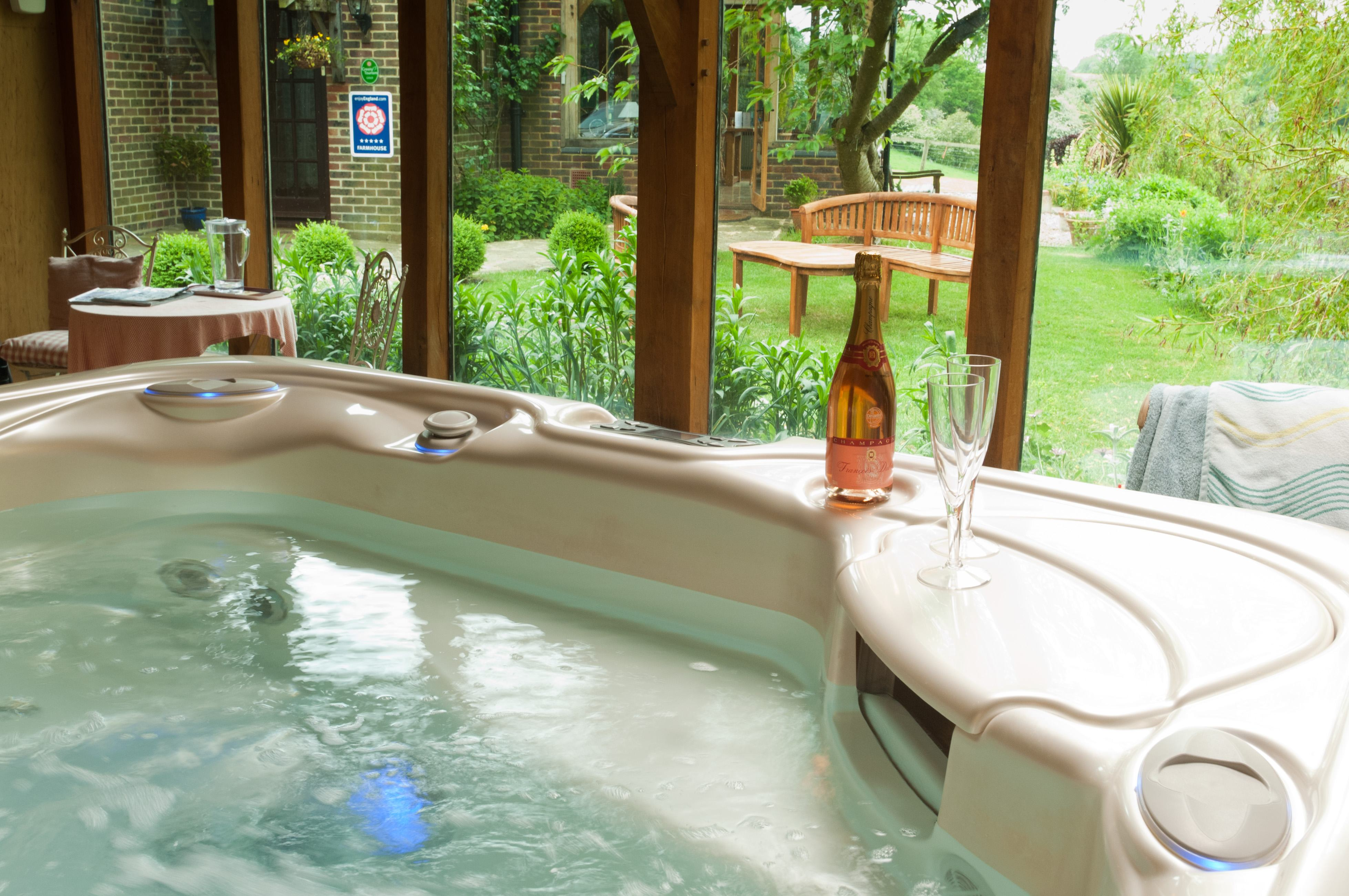 Hot tub with garden views | Alkham Court Farmhouse Bed and Breakfast