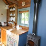 Kitchen area and woodstove at our Shepherds hut |Greenhill Glamping